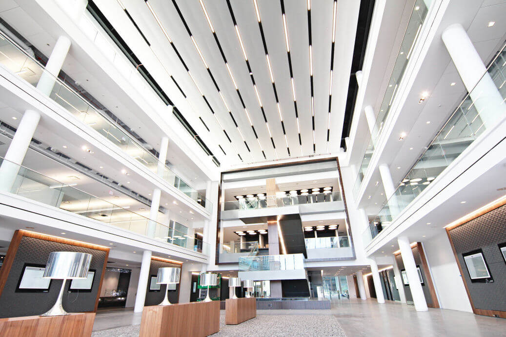 High-end finishes at Mercedes Benz headquarters in Atlanta included acoustical, GFRG columns, torsion spring ceilings, stretch fabric ceilings, tectum ceiling panels, wall protection, FRP, and plaster