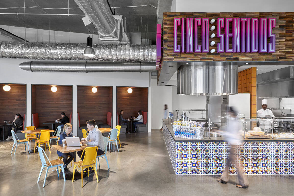 Exposed duct work and wood-paneled walls in employee cafeteria at NCR headquarters in Atlanta, GA