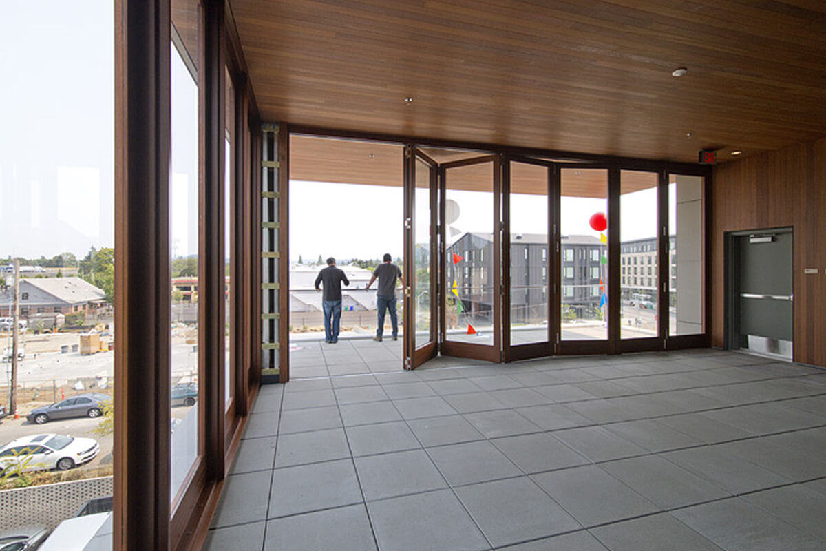 A third-floor terrace features a movable storefront system for all-season use.