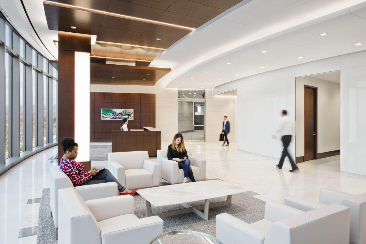 Retail banks lobby with white monochrome design and rich wood textures