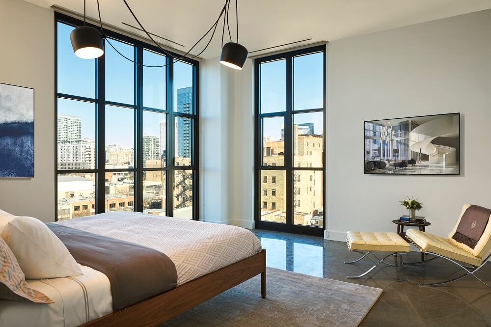 Inside a model apartment home at 900 W Washington which features floor-to-ceiling windows and city views