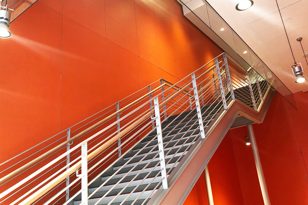 Orange wall and stairwell entrance at City Center Bishop Ranch shopping Center in Northern California