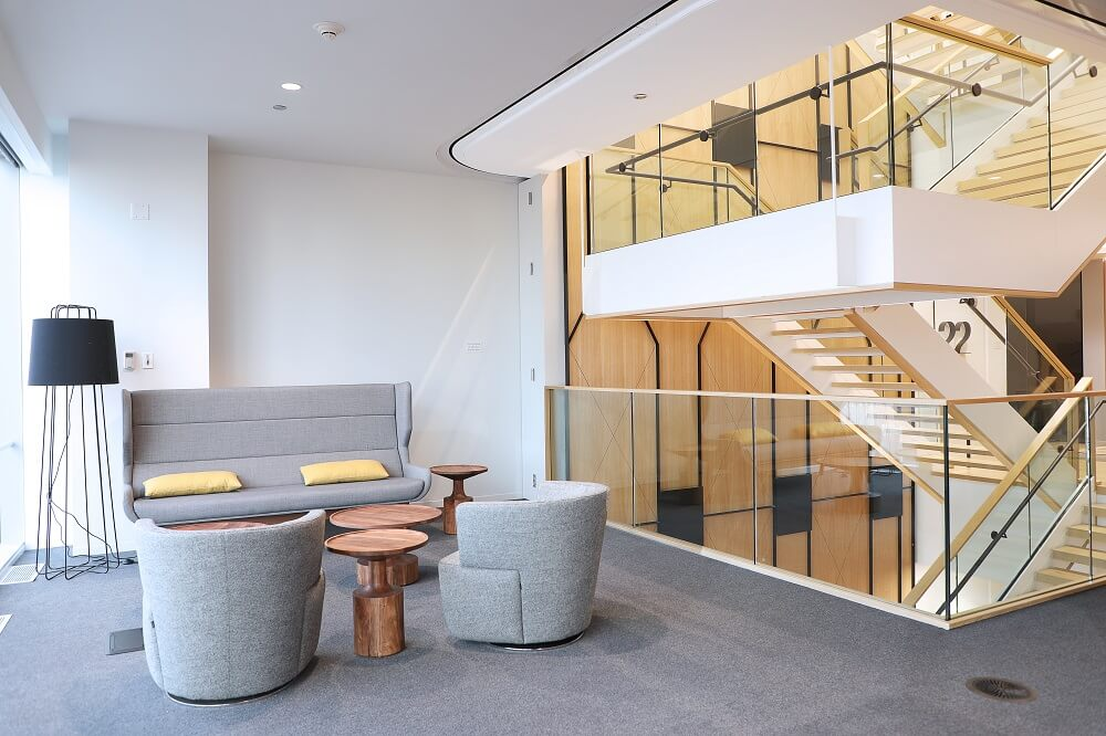 Open staircase with glass railings in light, bright corporate headquarters