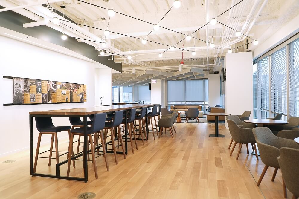 Light, bright company headquarters with high top bar seating for employees