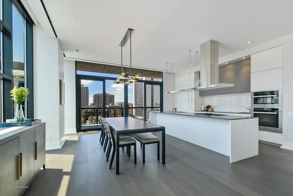 Inside model apartment home at 400 W Huron which features gourmet kitchens and floor-to-ceiling windows with city views