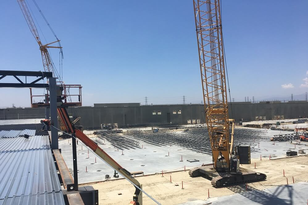 Cranes used to install metal decking installation at Goodman Commerce Center Eastvale in Southern California.